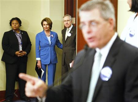 Pelosi and Reid arrive at a rally to celebrate Obamacare at the U.S. Capitol in Washington