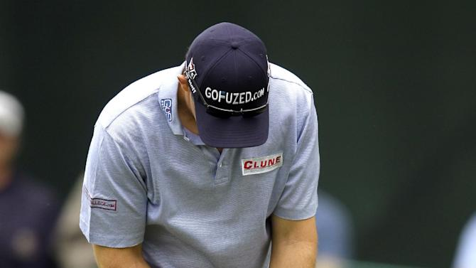 Padraig Harrington, of Ireland, putts with a belly putter on the 16th hole during the second round of the Wells Fargo Championship golf tournament at Quail Hollow Club in Charlotte, N.C., Friday, May 3, 2013. (AP Photo/Nell Redmond)