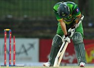 Pakistan cricketer Azhar Ali reacts after being dismissed by Sri Lankan cricketer Nuwan Kulasekara (unseen) during the second one-day international (ODI) match between Sri Lanka and Pakistan in Pallekele