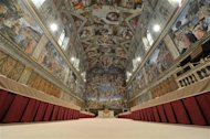 The Sistine Chapel is seen prepared with tables where cardinals will sit when the conclave begins, in a picture released by Osservatore Romano at the Vatican March 12, 2013. Roman Catholic cardinals will start a conclave on Tuesday to elect a successor to Pope Benedict, who abdicated last month. REUTERS/Osservatore Romano