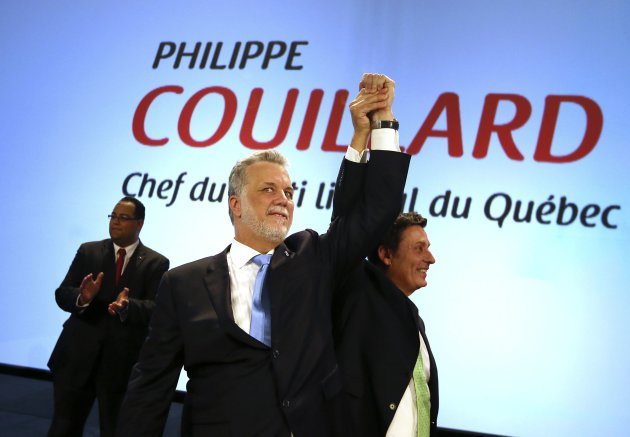 Runner up Moreau congratulates Couillard on his win as the new leader of the Quebec Liberal Party in Montreal