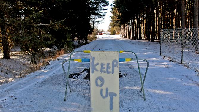 "A keep out sign stands at the property of Byron David Smith, in Little Falls, Minn., Monday, Nv. 26, 2012. Smith, a 64-year-old Minnesota homeowner who shot two teenagers in the midst of an apparent Thanksgiving Day break-in told authorities he feared they had a weapon, but acknowledged firing ""more shots than I needed to"" and appeared to take pride in ""a good clean finishing shot"" for one teen, according to investigators. He was charged Monday with two counts of second-degree murder. (AP Photo/The Star Tribune, Elizabeth Flores)  MANDATORY CREDIT; ST. PAUL PIONEER PRESS OUT; MAGS OUT; TWIN CITIES TV OUT"