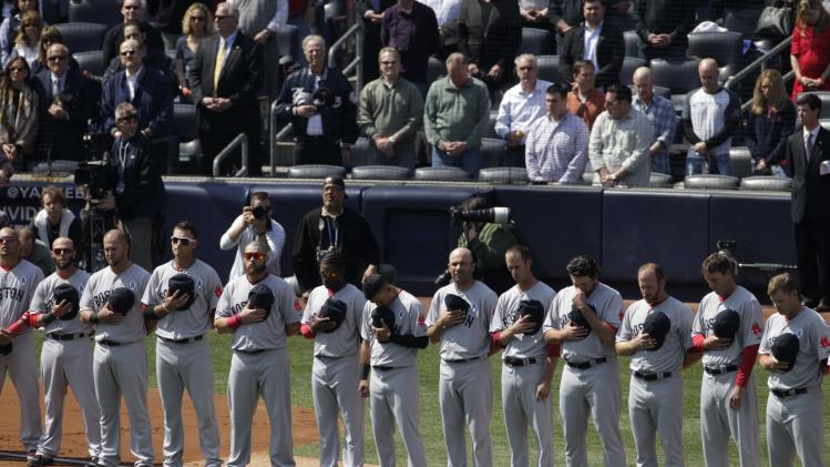Members of the Boston Red Sox bow their heads during a moment of silence in honor of those killed in the school shooting in Newtown, Conn., before an Opening Day baseball game against the New York Yankees at Yankee Stadium, Monday, April 1, 2013 in New York. (AP Photo/Mark Lennihan)
