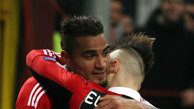 AC Milan's Kevin-Prince Boateng, left, is hugged by teammate Stephan El Shaarawy, after scoring during their Champions League round of 16, first leg soccer match against Barcelona, at the San Siro stadium in Milan, Italy, Wednesday, Feb. 20, 2013. (AP Photo/Felice Calabro')
