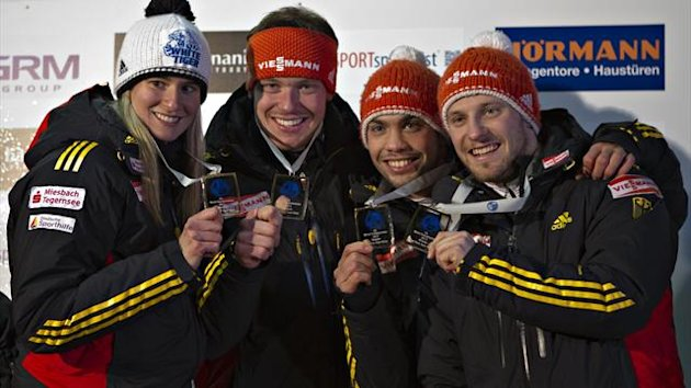 Germany's Natalie Geisenberger (L), Felix Loch (2nd L), Tobias Wendl and Tobias Arlt (R) hold their medals for first place in the team relay during the Luge World Championship in Whistler