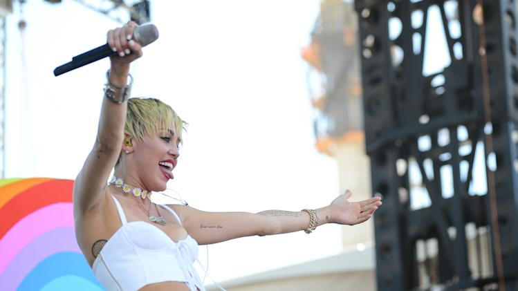 Miley Cyrus performs at IHeartRadio Music Village, Saturday, Sept. 21, 2013 in Las Vegas. (Photo by Al Powers/Powers Imagery/Invision /AP)