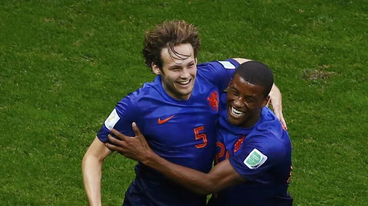 Blind of the Netherlands celebrates his goal against Brazil with teammate Wijnaldum during their 2014 World Cup third-place playoff at the Brasilia national stadium in Brasilia