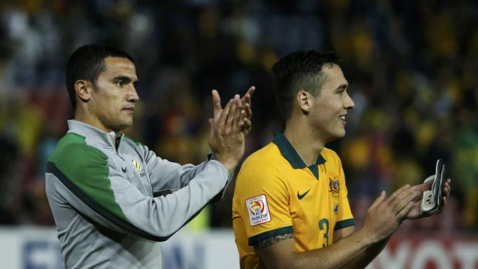 Australia's Tim Cahill acknowledges their supporters beside teammate Jason Davidson at the end of their Asian Cup semi-final soccer match against UAE at the Newcastle Stadium in Newcastle