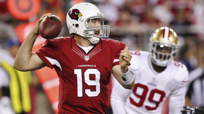 Arizona Cardinals quarterback John Skelton (19) looks to throw as San Francisco 49ers outside linebacker Aldon Smith (99) watches during the first half of an NFL football game, Monday, Oct. 29, 2012, in Glendale, Ariz. (AP Photo/Paul Connors)