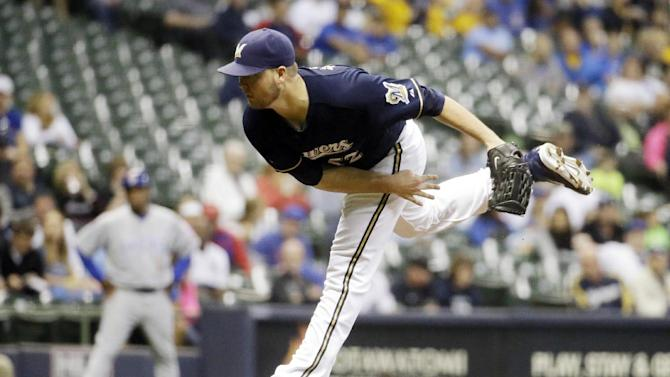 In this Sept. 26, 2014, file photo, Milwaukee Brewers starting pitcher Jimmy Nelson throws during the first inning of a baseball game against the Chicago Cubs in Milwaukee. The Brewers are down a workhorse starter and, for now, and a reliever who regularly closed games last season. Milwaukee seems like it will stay in-house and go with young right-hander Jimmy Nelson as the a rotation replacement, but could still look around for a closer. For now, Jonathan Broxton would be the favorite to close games