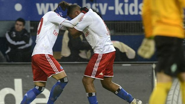 Hamburger SV's scorers Heung-min Son (L) and Dennis Aogo celebrate after scoring during their German Bundesliga first division match against Werder Bremen