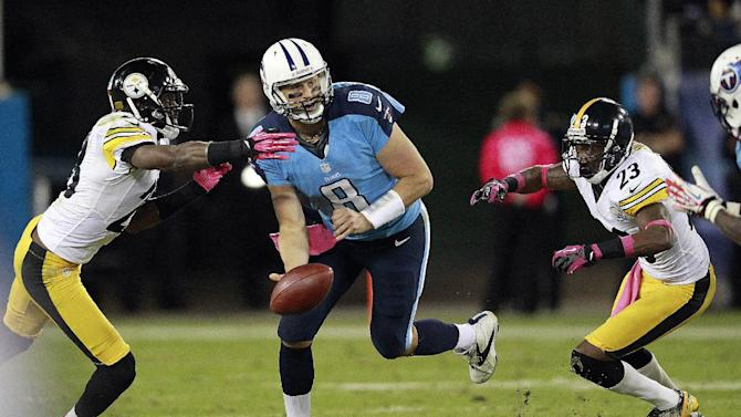 Tennessee Titans quarterback Matt Hasselbeck (8) flips the ball to a receiver while under pressure from Pittsburgh Steelers' Cortez Allen, left, and Keenan Lewis (23) during the first half of an NFL football game Thursday, Oct. 11, 2012, in Nashville, Tenn. (AP Photo/Wade Payne)