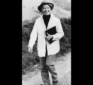 """FILE - Actress Katharine Hepburn strolls down a country lane on location near London during the filming of their made for TV movie, """"The Corn Is Green,"""" in this Jan. 23, 1979 file photo. """"The fact that she wore slacks and wanted to be comfortable influenced women's ready-to-wear in the United States,"""" said Jean Druesedow, director of the Kent State University Museum, which was given 700 items from Hepburn's estate.   (AP Photo/File)"""