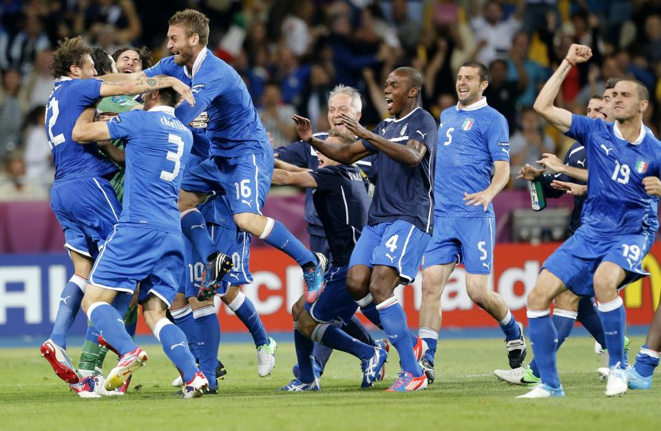 Italy players celebrate after Alessandro Diamanti scored the decisive penalty shootout during the Euro 2012 soccer championship quarterfinal match between England and Italy in Kiev, Ukraine, Monday, June 25, 2012. (AP Photo/Gregorio Borgia)