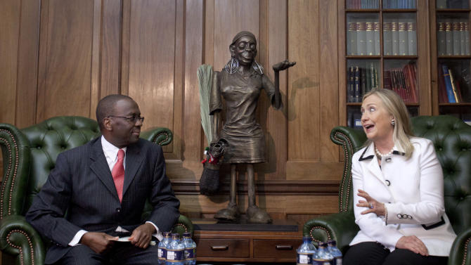 FILE - In this Saturday, Aug. 4, 2012 file photo, U.S. Secretary of State Hillary Rodham Clinton, right, meets Chief Justice Willy Mutunga at the Supreme Court of Kenya, in Nairobi, Kenya.  Mutunga is making an extraordinary public statement that he will not be cowed by threats and harassment ahead of the country's March 4 election, after receiving a threatening letter warning of dire consequences if the courts rule against the eligibility of two leaders who are facing trial at the International Criminal Court. (AP Photo/Jacquelyn Martin, Pool, File)