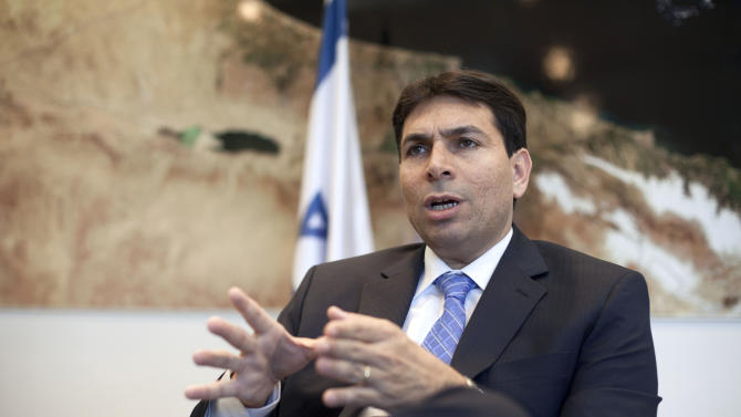 In this photograph made on Thursday, June 27, 2013, Israeli Deputy Minister of Defense Dani Danon speaks during an interview to the Associated Press in his office in Tel Aviv, Israel. Danny Danon says he has no problem with his party leader, Israel's prime minister _ so long as he doesn't make peace. The ambitious deputy defense minister isn't a household name internationally yet, but at home he has emerged as an unlikely opponent to Benjamin Netanyahu and his strongest opposition within the hawkish ruling Likud Part (AP Photo/Dan Balilty)