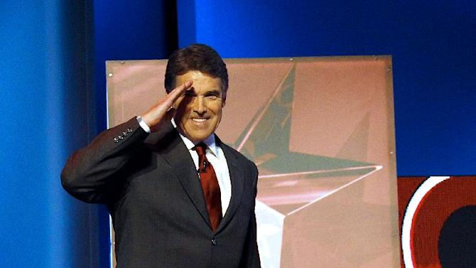 Republican presidential candidate Texas Gov. Rick Perry salutes as he arrives for a Republican presidential debate Monday, Sept. 12, 2011, in Tampa, Fla. (AP Photo/Chris O'Meara)