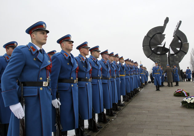 A Serbian military honor guard stand to attention during commemorations for victims of the Holocaust at a monument erected in the former World War II Nazi concentration camp of Sajmiste in Belgrade, S