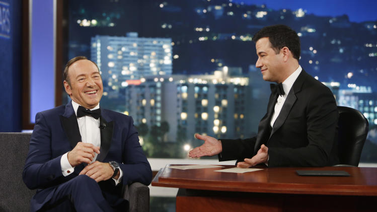 """In this image provided by ABC, Kevin Spacey appears on the 9th annual """"Jimmy Kimmel Live: After the Oscars"""" special in Los Angeles on March 2, 2014. Spacey's appearance followed a brief cameo by Toronto Mayor Rob Ford, who was scheduled to appear on the March 3 show. Ford is claiming he wouldn't know Kevin Spacey """"if I ran over him,"""" after the House of Cards star poked fun at the mayor after his cameo. (AP Photo/ABC, Randy Holmes)"""