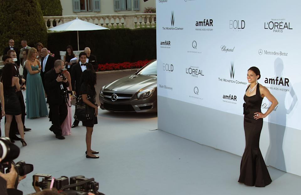 Michelle Rodriguez arrives for the amfAR Cinema Against AIDS benefit at the Hotel du Cap-Eden-Roc, during the 65th Cannes film festival, in Cap d'Antibes, southern France, Thursday, May 24, 2012. (AP Photo/Joel Ryan)