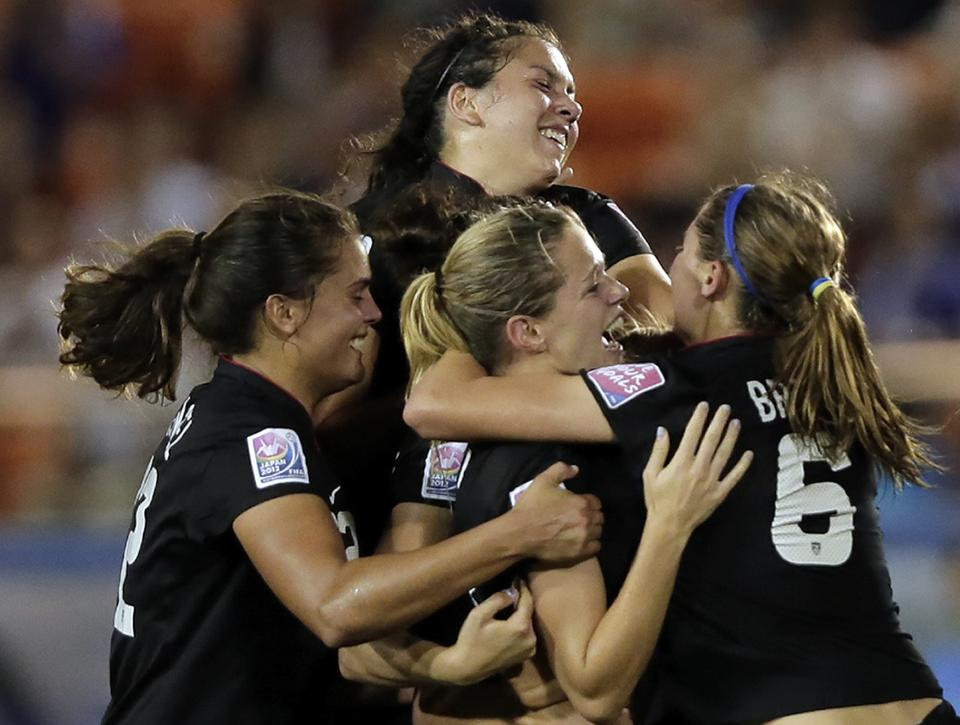 Kealia Ohai, ,center, of the United States celebrates with teammates after scoring a goal against Germany during their final match of the U20 women's World Cup in Tokyo, Saturday, Sept. 8, 2012. (AP Photo/Itsuo Inouye)