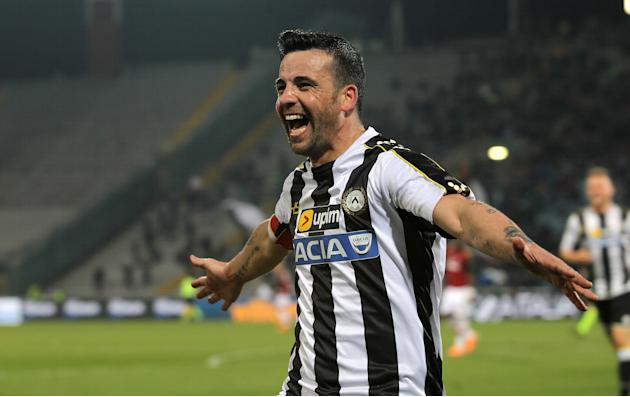 Udinese's Antonio Di Natale, celebrates after scoring during the Serie A soccer match between Udinese and AC Milan at the Friuli Stadium in Udine, Italy, Saturday, March 8, 2014