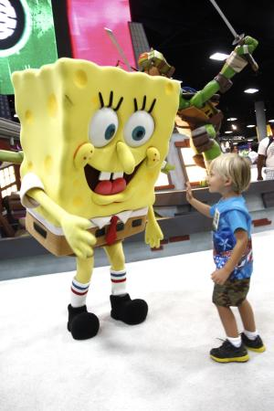 FILE - In this July 15, 2012 publicity photo provided by Nickelodeon, a fan is seen with SpongeBob SquarePants during Comic-Con, in San Diego, Calif. Storm Troopers, cyborgs, superheroes and other comic-book fans can count on their annual pilgrimage to San Diego for another four years. San Diego Mayor Jerry Sanders announced Monday, Oct. 29, 2012, that Comic-Con has extended its contract with the city through 2016. (AP Photo/Nickelodeon, Joe Kohen, File)