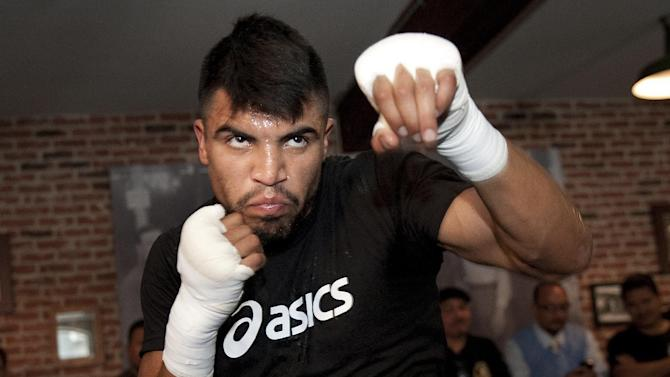 """FILE - This June 20, 2012 file photo shows boxer Victor Ortiz training during the media workout at Fortune Boxing Gym in Los Angeles. Ortiz  is one of eleven celebrity contestants who will compete on the next edition of """"Dancing with the Stars."""" The new season kicks off on ABC with a two-hour premiere on March 18. (AP Photo/Grant Hindsley, file)"""
