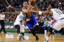 Golden State Warriors' Stephen Curry (30) tries to get between Boston Celtics' Evan Turner (11) and Isaiah Thomas (4) during the second quarter of an NBA basketball game in Boston, Sunday, March 1, 2015. (AP Photo/Winslow Townson)