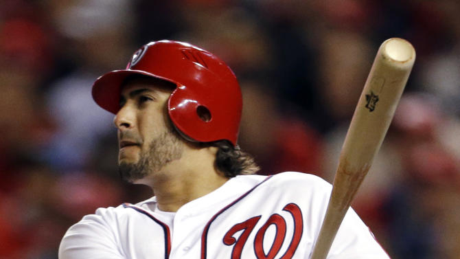 FILE - In this Oct. 12, 2012, file photo, Washington Nationals' Michael Morse watches his two-run home run in the third inning of Game 5 of the National League division baseball series against the St. Louis Cardinals in Washington. The Nationals traded power-hitting Morse to Seattle on Wednesday, Jan. 16, 2013, in a three-team deal that moved catcher John Jaso from the Mariners to the Oakland Athletics. (AP Photo/Pablo Martinez Monsivais, File)