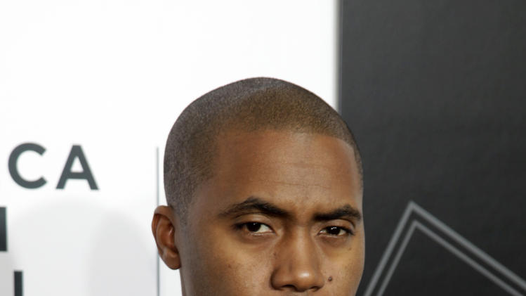 "Recording artist Nas attends the world premiere of ""Time Is Illmatic"" at the 2014 Tribeca Film Festival on Wednesday, April 16, 2014, in New York. (Photo by Andy Kropa/Invision/AP)"