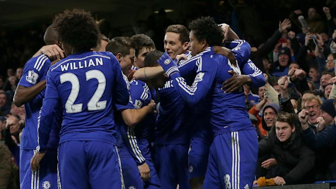 Chelsea's Loic Remy, right, celebrates after scoring a goal with his teammates during the English Premier League soccer match between Chelsea and Manchester City at Stamford Bridge, London, England, Saturday, Jan. 31, 2015. (AP Photo/Tim Ireland)