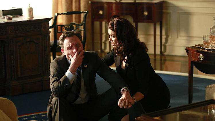 "This image released by ABC shows Tony Goldwyn, left, and Bellamy Young in a scene from the third season finale of ""Scandal,"" which aired on Thursday, April 17, 2014. (AP Photo/ABC, Ron Tom)"