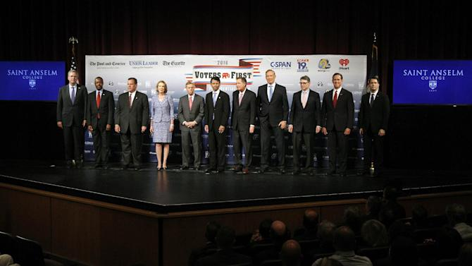 Republican presidential candidates gather on stage before a forum  Monday, Aug. 3, 2015, in Manchester, N.H. From left: Jeb Bush, Ben Carson, Chris Christie, Carly Fiorina, Lindsey Graham, Bobby Jindal, John Kasich, George Pataki, Rick Perry, Rick Santorum, and Scott Walker. (AP Photo/Bill Sikes)