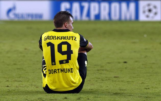 Borussia Dortmund's Grosskreutz sits on the field after their Champions League Group F soccer match against Napoli in Naples