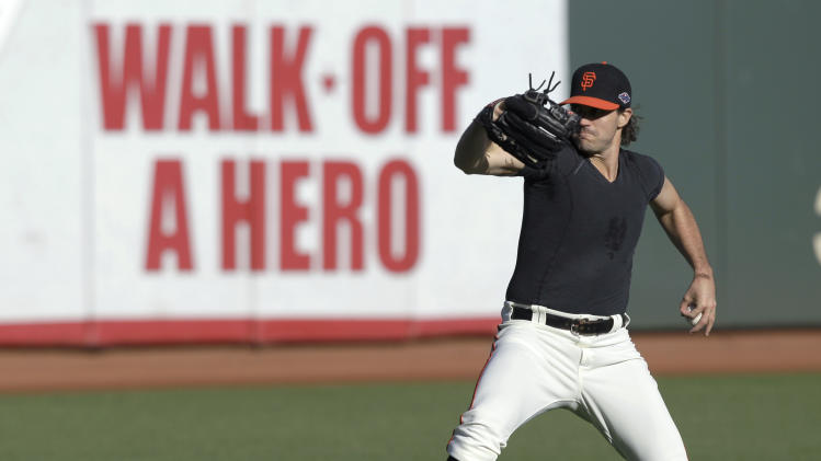 San Francisco Giants pitcher Barry Zito winds up during a voluntary practice in preparation for Sunday's Game 6 of the National League championship baseball series against the St. Louis Cardinals, Saturday, Oct. 20, 2012, in San Francisco. (AP Photo/Ben Margot)