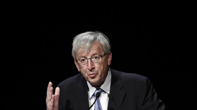 File photo of Luxembourg's then PM Juncker gesturing as he delivers his speech on the prospects of the euro in Athens