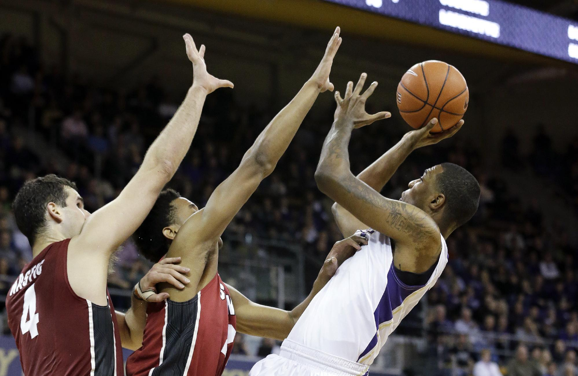Stanford eases past short-handed Washington, 84-74