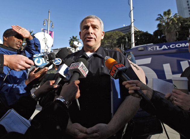 LAPD spokesman Lt.  Andrew Newman talks to reporters at a news conference in Los Angeles, Tuesday, Feb. 12, 2013. Police are now investigating more than 1,000 tips from the public in the search for Ch