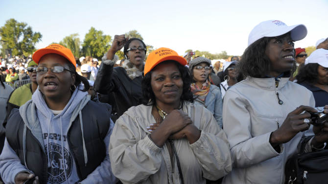 Members of the public take part in the dedication of the Martin Luther King, Jr., Memorial, in Washington, Sunday, Oct. 16, 2011. (AP Photo/Cliff Owen)