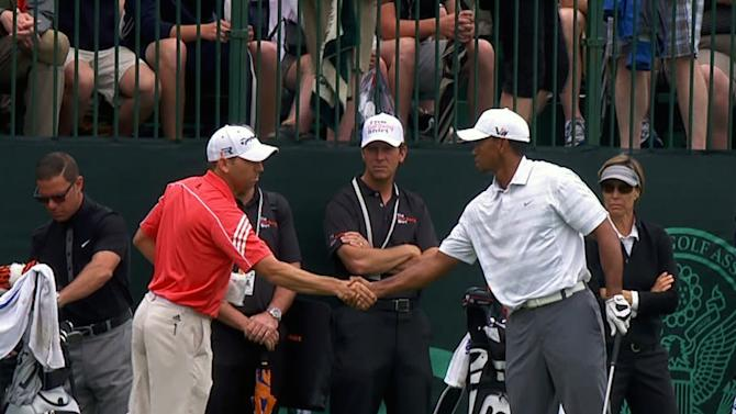 In this Monday, June 10, 2013 image taken from video and provided by The Golf Channel, Sergio Garcia, left, and Tiger Woods shake hands on the driving range during practice for the U.S. Open golf tournament at the Merion Golf Club in Ardmore, Pa. (AP Photo/Courtesy of the Golf Channel)