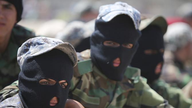 Shiite volunteers from the Iraqi Ketaeb Hezbollah, join the Iraqi army to fight against Jihadist militants of the Islamic State (IS), in Baghdad on July 9, 2014