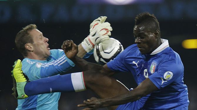 In this Oct. 15, 2013, file photo, Italy's Mario Balotelli, is blockes from scoring during a 2014 FIFA World Cup, Group B, qualification match between Italy and Armenia in Naples, Italy
