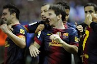 Barcelona's Lionel Messi (C) celebrates with teammates after David Villa scored a goal during their Spanish La Liga match against Sevilla, on September 29, at the Ramon Sanchez Pizjuan stadium in Sevilla. Barca won 3-2
