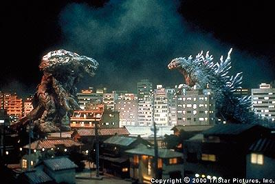 The fate of a city, and ultimately all humanity, rests in Godzilla's (right) giant claws as he prepares to battle the alien life form Orga in the Toho Presentation/TriStar Pictures Release, Godzilla 2000 .