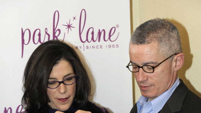Director Alexandra Pelosi, left, and former New Jersey Gov. Jim McGreevey visit Park Lane jewelry at the Fender Music lodge during the Sundance Film Festival on Sunday, Jan. 20, 2013, in Park City, Utah. (Photo by Jack Dempsey/Invision for Fender/AP Images)