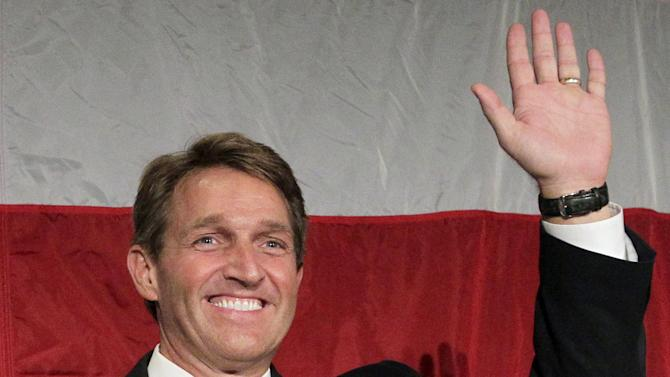 FILE - In this Nov. 6, 2012 file photo, Sen.-elect, current Rep. Jeff Flake, R-Ariz., waves during an election night party in Phoenix. (AP Photo/Matt York, File)