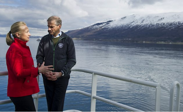 US Secretary of State Hillary Rodham Clinton and Norway's Minister of Foreign Affairs Jonas Gahr Stoere, right, talk together onboard the Arctic Research vessel Helmer Hanssen on a fjord, near the northern Norwegian city of Tromso, Norway, Saturday June 2, 2012. Clinton is trekking north of the Arctic Circle, a region that could become a new international battleground for resources.