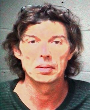 Paul Matthew Comer is seen in an undated photo provided by the Paulding, Ga. County Sheriff's Office. Investigators were planning to search the Dallas, Ga., of Paul and Sheila Comer, a Georgia couple accused of child cruelty after an emaciated 18-year-old said he was kept there in isolation for years and then dumped by bus in Los Angeles. Mitch Comer told police his stepfather gave him $200 and a list of homeless shelters before he was put on a bus to Los Angeles on this 18th birthday, police in Los Angles said Thursday, Sept. 20, 2012. Stepfather Paul Comer and mother Sheila Comer faced charges of false imprisonment and cruelty to children, Paulding County jail records show. They were being held without bond. (AP Photo/Paulding County, Ga., Sheriff's Office)