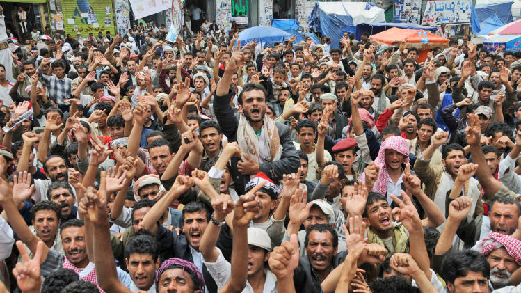 Anti-government protestors shout slogans during a demonstration demanding the resignation of Yemeni President Ali Abdullah Saleh, in Sanaa, Yemen, Wednesday, July 13, 2011. (AP Photo/Mohammed Hamoud)